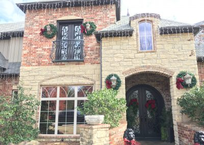 custom-two-doors-with-balcony-christmas-wreaths-lights